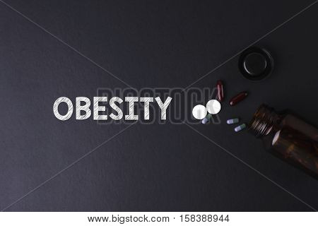 Obesity Word With Medicine And Bottle - Health Concept. Medical Conceptual.