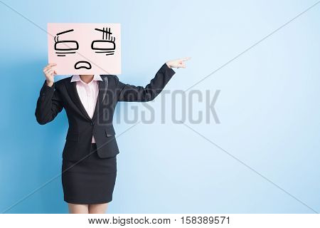 business woman take tired billboard and show somethingisolated blue background