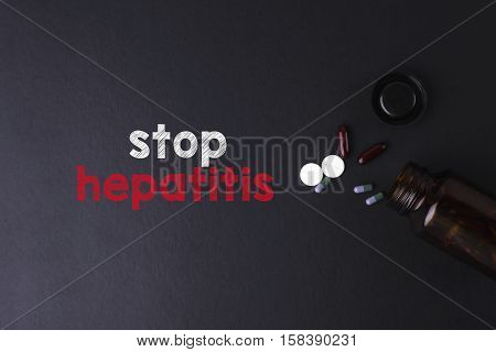 Stop Hepatitis Word With Medicine And Bottle - Health Concept. Medical Conceptual.