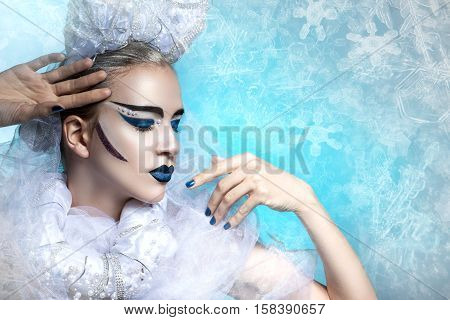 Winter portrait of a woman with creative makeup. snowy beauty. Flawless makeup, perfect shape. Cold beauty