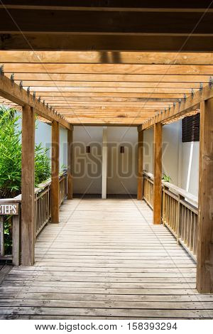 wooden beams along a wooden floor path