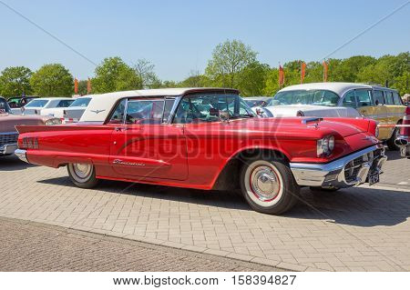 DEN BOSCH THE NETHERLANDS - MAY 8 2016: 1960 Ford Thunderbird on the parking lot at the Rock Around The Jukebox event.