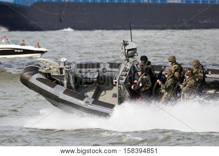 ROTTERDAM NETHERLANDS - SEP 3 2016: Dutch Marines in a speedboat during an assault demo at the World Harbor Days in Rotterdam.