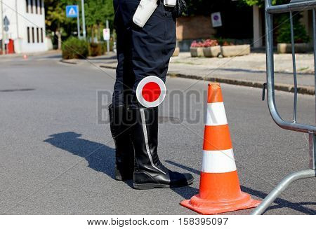 Policeman With Black Boots And Paddle Traffic