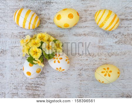 Easter Eggs And Yellow Primrose Flowers Composition