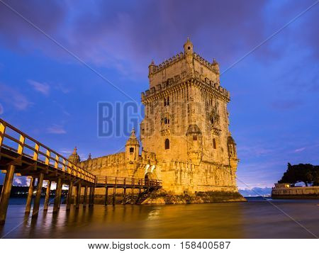 Torre de Belem on the bank of Tagus river in Lisbon Portugal at night.