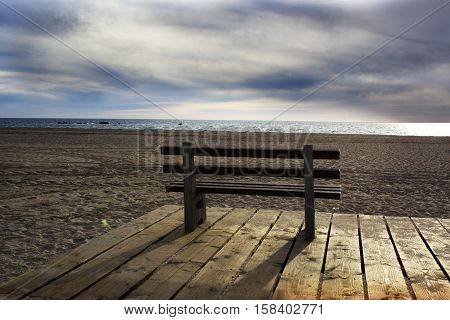bench on a background of ocean. empty bench on the background of the ocean at sunset. empty bench on the beach