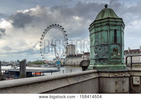 LONDON, ENGLAND - JUNE 16 2016: The London Eye and County Hall, Westminster, London, England, Great Britain