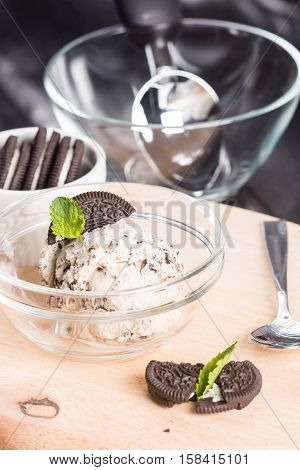 homemade cookies and cream ice cream topped with mint leaf