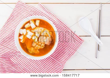 kimchi soup with pork belly and silken tofu