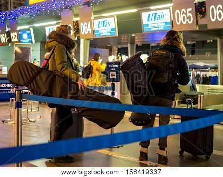 Moscow, Russia - December 29, 2015: Passengers with inventory for the winter sports awaiting registration at the airport Vnukovo