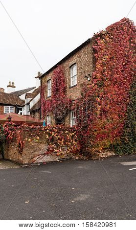 Winslow, Buckinghamshire, United Kingdom, October 25, 2016: The Bell Hotel With Red Creeping Ivy On