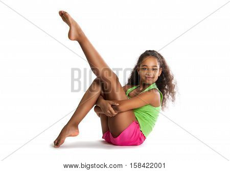 Little Girl Gymnast Doing Exercises. Cheerful Child Aerobics