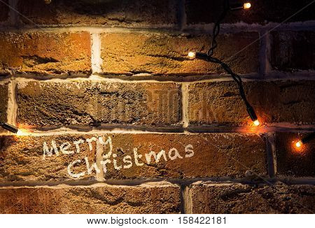 christmas vintage brick wall background with lights glowing card