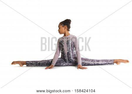Little Girl Doing Gymnastics. Transverse Split Sitting On The Floor