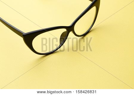 Black eyeglasses with transparent lenses