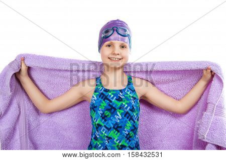 Portrait Of A Young Girl In Goggles And Swimming Cap.