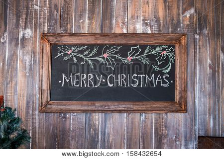 Merry Christmas Christmas decoration with merry christmas on blackboard over wooden background