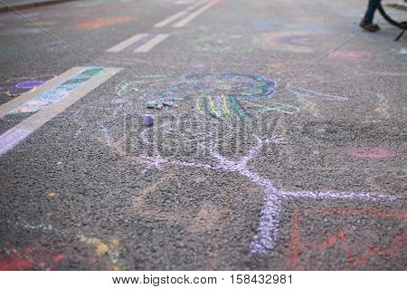 Children's Drawing With Chalk On A Pavement