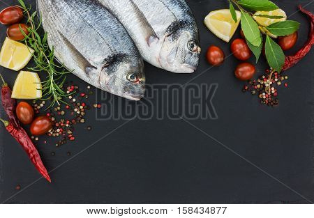Two Fresh Dorado Fish On Black Slate Cutting Board. Top View, Copy Space