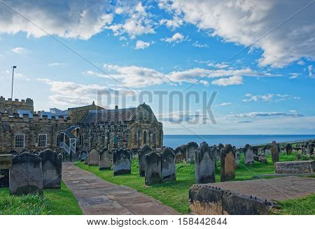 Whitby, UK - May 11, 2011: Whitby Churchyard and Cemetery North Yorkshire the UK. It is ruins of the Benedictine abbey. Now it is under protection of the English Heritage.