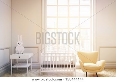 Front view of a baby's room interior with a cradle an armchair and a bedside table. There is a large window with a cityscape. 3d rendering. Mock up. Toned image