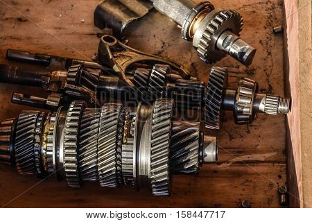 Dismantled Box Car Transmissions. The Gears On The Shaft Of A Mechanical Transmission