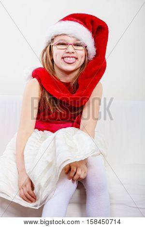Girl In Santa Hat Making Funny Face