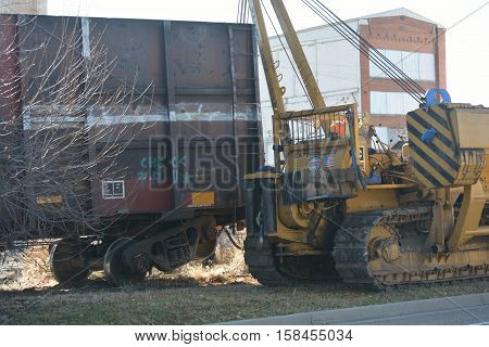 LOVELAND COLORADO USA - NOVEMBER 25 2016: Following a freight train derailment work crews from Hulcher Professional Services attempt to rerail the derailed cars.