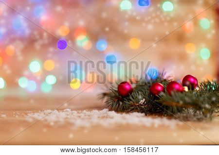 Christmas and new year background. fir branches and Christmas decorations on festive background. the photo has a empty space for your text