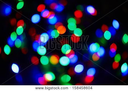 Abstract circular blue red green bokeh background of Christmaslight