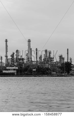 Black and White, Oil refinery river front