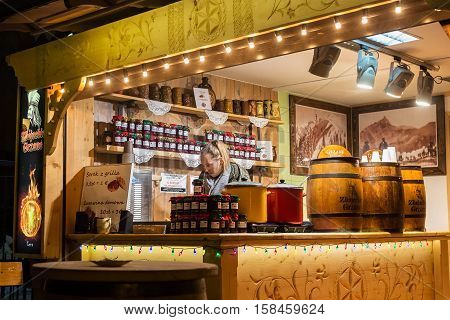 POLAND ZAKOPANE - JANUARY 03 2015: Wooden outdoor shop with jam cheese and hot wine during the Christmas holidays in Zakopane. Town known as the winter capital of Poland. It is a popular resort.