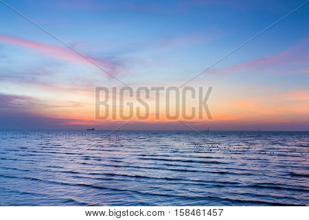 Beautiful after sunset sky over the seacoast, natural landscape background