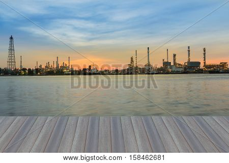 Opening wooden floor, Sunrise over oil refinery river front panorama