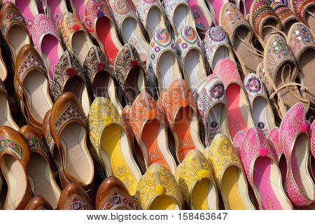 JAIPUR, INDIA - FEBRUARY 16: Display of traditional shoes at the street market in Jaipur. Jaipur is the capital and the biggest city of Rajasthan, India on February 16, 2016.