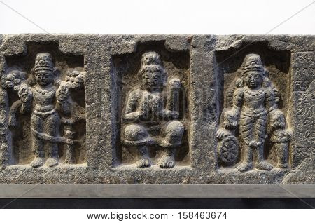 KOLKATA, INDIA - FEBRUARY 09, 2016:  Lintel: Surya, Siva Lakulisa and Vishnu, 26th regnal year of Dharmapala, ca. 770-810 C.E. found in Bodhgaya, Bihar now exposed in the Indian Museum Kolkata, India