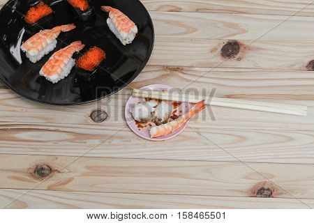 Sushi Close up in black plate on wooden background Asian food delicious