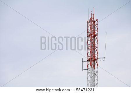 Telecommunication tower with antennas communication telecom radio telephone mobile phone on sky background