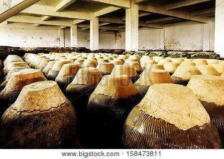 Shanghai Jugs of distilled rice liquor at Sanbai Wine Workshop in Wuzhen historic scenic town.