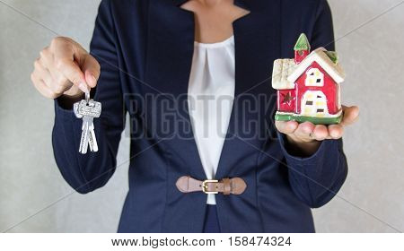 House in hand. Keys in a hand