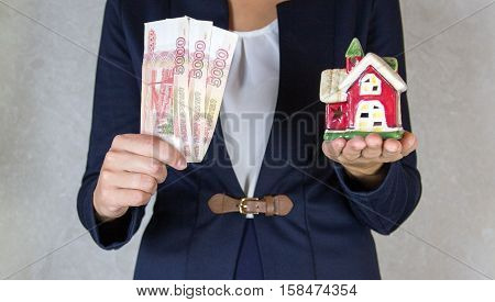 House and money in hand . .