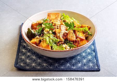 Panir apple nuts and herb salad on plate