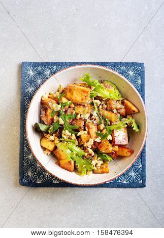 Panir apple nuts and herb salad on plate top view