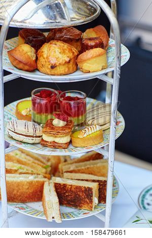 Selection Of Sandwiches And Fancy Cakes