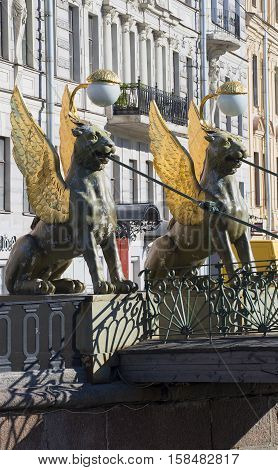 SAINT PETERSBURG, RUSSIA - JUNE 29, 2015: The two griffins on the Bank bridge with an odd side of the Griboyedov canal. The historical landmark of the city Saint Petersburg