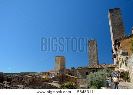 San Gimignano Italy - September 6 2016: View of San Gimignano city in Tuscany Italy. Unidentified people visible.