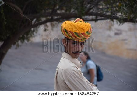 JODHPUR, RAJASTHAN - FEBRUARY 10, 2016 - Portrait of an unidentified indian man with mustaches and turban inside Mehrangarh fort
