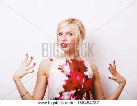young pretty blonde real girl presenting something at white copy space, isolated on white background gesturing emotional