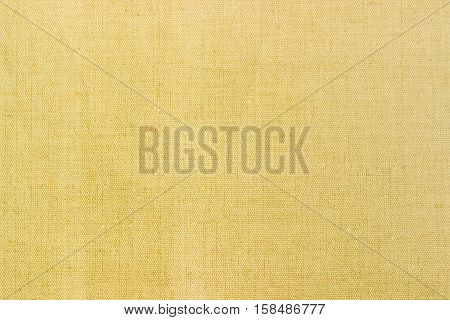 Background of a burlap made of unpainted spinning natural fibers closeup